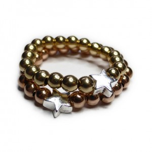 Stack of Gold and Rose Gold Filled Ball Rings with Sterling Silver Star Charm