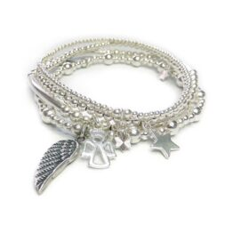 The Sterling Silver Heavenly Bracelet Stack with Angel, Star & Wing Charms